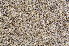 Horizontal gravel texture from quartz stones. High res macro photo Royalty Free Stock Photography