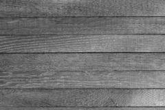 Horizontal grayscale wooden table background. Top view. Copy space. Horizontal grayscale wooden table background. Old dark burnt oak. Top view. Copy space. Close stock photography