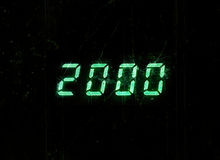 Horizontal green digital 2000 millenium display clock dust parti Stock Photo