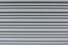 Horizontal grey metal stripe pattern. In close up view Royalty Free Stock Photos