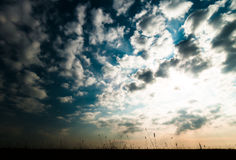 Horizontal ground silhouette with dramatic clouds Stock Photos