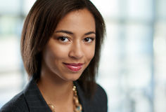Horizontal headshot of an attractive african american business woman shot with shallow depth field. Royalty Free Stock Photography