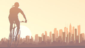 Horizontal illustration of cyclist rides in big city at sunset. Stock Photo
