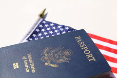 A horizontal image of an American passport. On an American flag Royalty Free Stock Image