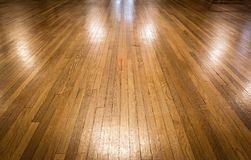 Old shiny polished hardwood floor. Horizontal image of a bare vintage shiny and polished hardwood floor great for a background Stock Photos
