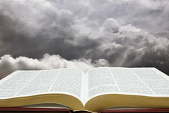 Bible & Creation Sky. Horizontal image of Bible and creation sky Royalty Free Stock Photo