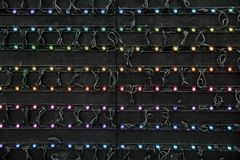 Horizontal image of black background with colorful strings of light Royalty Free Stock Photography
