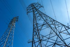 High voltage electrical power lines and blue sky royalty free stock images