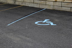 Parking lot with lines for cars and well-marked handicapped spot Royalty Free Stock Image