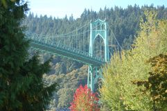 St. John`s Bridge in Autumn near Portland, Oregon surrounded by trees. This is a horizontal image of St. John`s Bridge near Portland, Oregon surrounded by trees royalty free stock photography