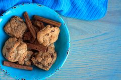 Cookies gourmet inside a blue bowl with cinnamon sticks royalty free stock photography