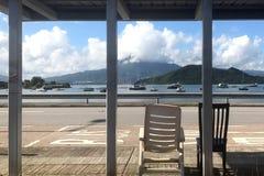 Horizontal lake, mountain, green tree, bus stop station and two royalty free stock photos