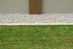 Horizontal lawn border. Made of tiles and crushed rocks stock photo