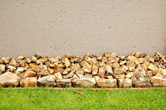 Horizontal lawn border with rocks. Horizontal lawn border made of large light brown crushed rocks stock images