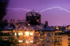 Horizontal lightning, night storm in the city Stock Images