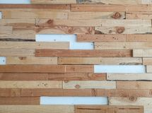 Horizontal line random pattern of brown pine wood decorated on white color concrete wall for interior decor royalty free stock image