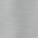 Horizontal lined brushed metal surface that can be. Seamlessly tiled Royalty Free Stock Images
