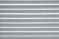 Horizontal lines pattern. White and gray horizontal parallel stripes, texture, plastic, lights and shadows Stock Photos