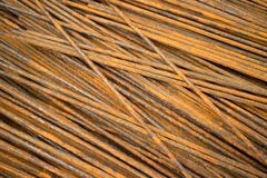 Horizontal MCU of smooth semi-rusty steel bars stacked in a diagonal position Stock Photos