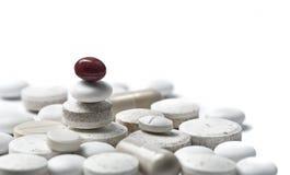Horizontal metaphore pills in ballance Stock Photos
