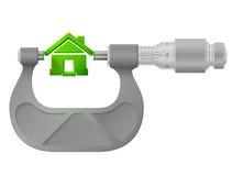 Horizontal micrometer measures house symbol Stock Photography