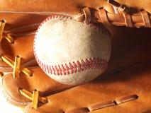 Horizontal mitt and baseball. A horizontal close up of a baseball in a mitt Stock Photography