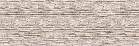 Horizontal modern slate brick wall for pattern and background.  Royalty Free Stock Image
