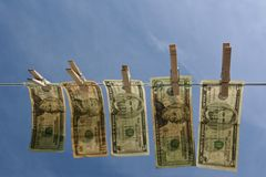 Horizontal Money on Clothesline Royalty Free Stock Images