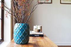 Horizontal moroccan teal vase with clear space for text on white Stock Image
