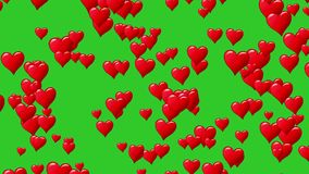 Horizontal motion of red hearts at green background. Motion graphic. Seamless loop. Track to right. Red at green stock footage