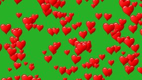 Horizontal motion of red hearts at green background. Motion graphic. Seamless loop. Track to right. Alpha channel. Horizontal motion of red hearts at green stock footage
