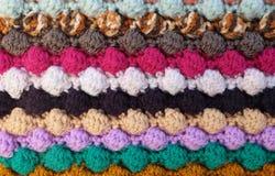 Horizontal multi-coloured stripes of bobble crochet stitches bac. Horizontal multi-coloured stripes of bobble crochet stitches as abstract background texture Royalty Free Stock Photo