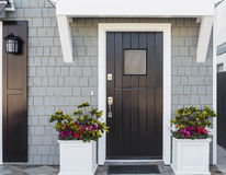 Horizontal Of Black Front Door To Family Home Stock Photos