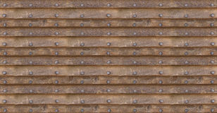 Horizontal old brown boards with copper rivets in a row symmetrical and smooth texture Royalty Free Stock Images