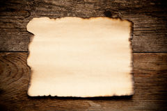 Horizontal old paper on wooden background Stock Images