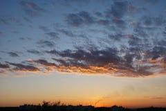 Horizontal orange blue dramatic cloudscape Stock Image