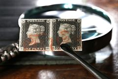 Penny Black. Horizontal pair of plate 1b Penny Black with red Maltese cross cancellation. It is the world`s first adhesive postage stamp stock photo
