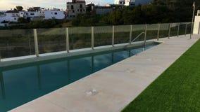 Horizontal panning over closed pool. Horizontal panning over pool, handheld stabilised footage stock video footage