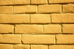 Yellow brick wall background for designers stock photos
