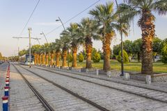 Horizontal perspective shot of tramway in movement with pedestrian stones at sunset time in Izmir at Turkey stock image