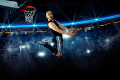 Horizontal photo of basketball player in the game makes reverse Royalty Free Stock Images