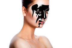 Horizontal photo of beauty woman with black paint on face Royalty Free Stock Photography