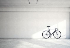 Horizontal Photo Blank Grungy Smooth Bare Concrete Wall in Modern Loft Studio with Classic bicycle. Soft Sunrays. Reflecting on Wood Surface. Empty Abstract Royalty Free Stock Images