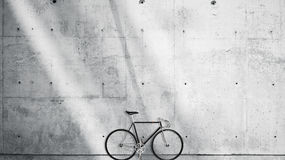 Horizontal Photo Blank Grungy Smooth Bare Concrete Wall in Modern Open Space Studio with Classic bicycle. Soft Sunrays. Reflecting on Surface. Empty Abstract Stock Photos