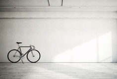 Horizontal Photo Blank Grungy Smooth Bare Concrete Wall in Modern Open Space Studio with Classic bike. Soft Sunrays. Horizontal Photo Blank Grungy Smooth Bare Stock Image
