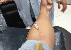 Horizontal photo of closeup asian male get injection on his arm. Before blood donation Stock Image