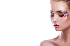 Horizontal photo of cutie young girl with professional make up i Royalty Free Stock Images