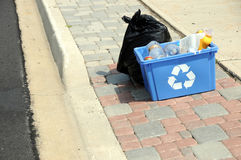 Horizontal photo of garbage and recycling on curb Royalty Free Stock Photo