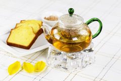 Fresh Green Tea in Glass Pot with Lemon Cake on the side Stock Photos