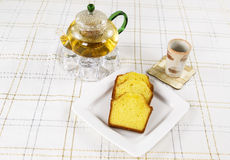 Fresh Lemon Pound Cake with Green Tea on table Royalty Free Stock Images